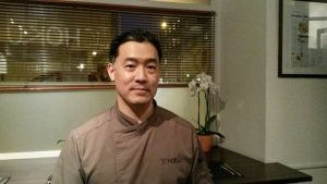 Photo of Chef Ryan Shibuya in the comfortable surroundings of his restaurant.