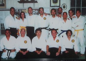 Photo of Dr. Sugiki (kneeling, fourth from left) with his fellow Manoa Aiki Dojo aikido club members.