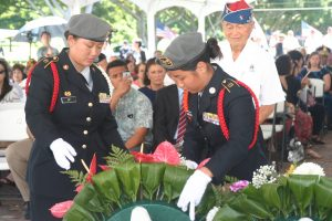 Photo of Yasunori Deguchi, a 442nd RCT veteran watches as cadets place floral arrangement