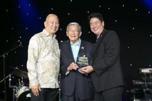 "Photo of NEC board chair Bill Seki (left) and interim executive director Dr. Mitch Maki present the organization's ""Defining Courage Award"" to former U.S. Transportation (and Commerce) Secretary Norman Mineta"