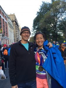 Photo of Meredith's boyfriend, Franz Juola, posing with Meredith at the finish line