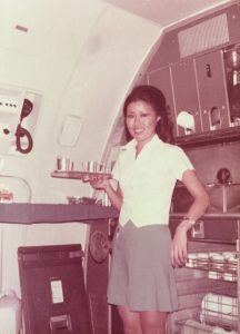 Photo of Akiko Ogura preparing a first-class meal in the galley of a Boeing 707