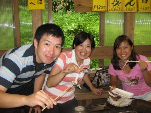 Photo of Keisuke, Reiko Araragi, and Kelly eating Kelly's catch in 2011 from a fishing excursion. (Photos courtesy Patsy Iwasaki)
