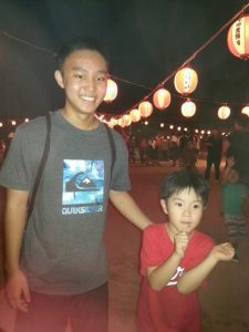 "Photo of Jairus looking after his ""little brother"" Shogo at an outing."