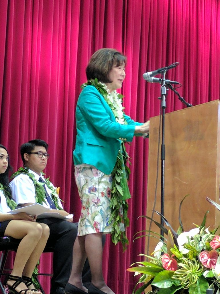 Photo of Frances Kakugawa giving her commencement address to Pähoa High School's 2017 graduating class