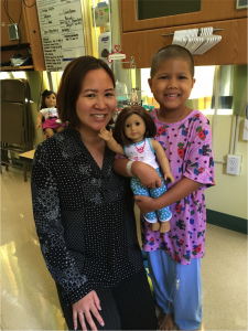 Six-year-old Mikaela Bland Lessary with pediatric oncology hospitalist Dr. Kelley Chinen-Okimoto after being admitted to Kapi'olani for a haplo-identical bone marrow transplant.
