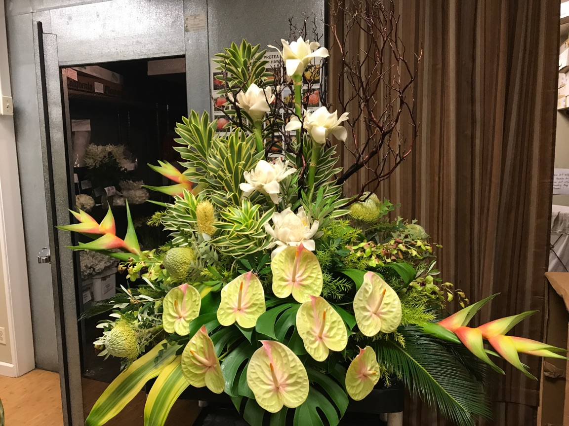 Photo of anthuriums, bird of paradise, ti leaves, proteas, and other tropical and local foliage arrangement by Asa Flowers