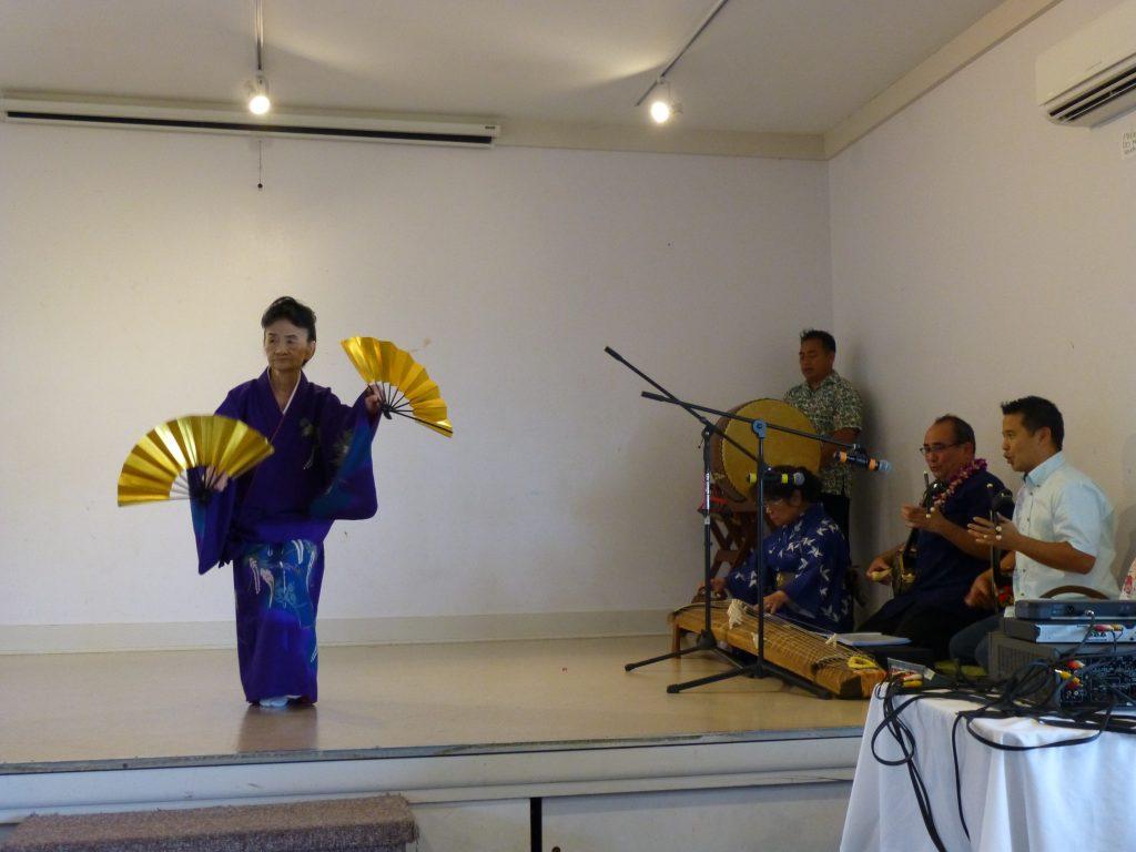 "Toshiko Nakamoto dances to music performed by Afusoryu sanshin sensei Kenton Odo and Grant ""Sandaa"" Murata, koto by Yasuko Arakawa-Sensei and taiko by Tom Yamamoto."