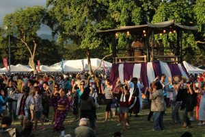 Photo of attendees enjoying a bon dance at a past Okinawan Festival