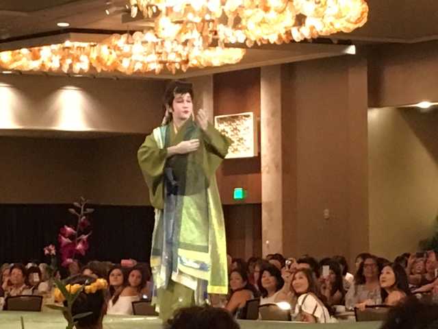 Japanese and Okinawan dancer Dazzman Toguchi models a costume created for him by Janice Tsujimura.