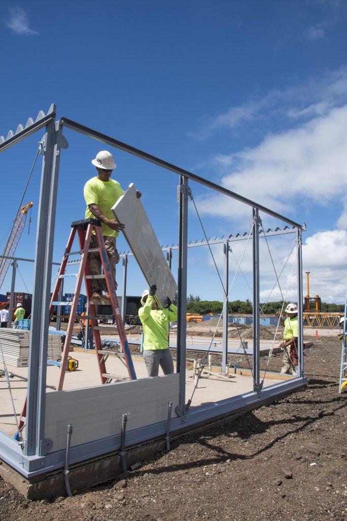 Coastal Construction crews gently slide the homes' metal walls into place. (Photos by Gregg Kakesako)